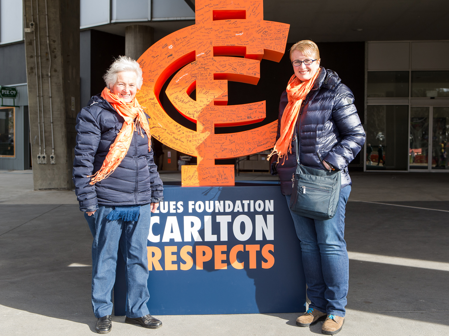 Supporters next to their pledge on the CARLTON RESPECTS monogram