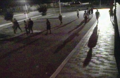 CCTV footage of a group of youths on Midland's streets at night.