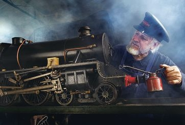Tom Winterbourn at work on his lovingly constructed miniature steam locomotive.