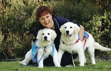 Assistance Dogs Australia's Helen Stathy with Ollie and Flair. Picture: Martin Kennealey www.communitypix.com.au d408371