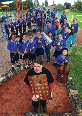 Orana Catholic Primary School music specialist Sarah Draper with school band members. Picture: David Baylis www.communitypix.com.au d407697