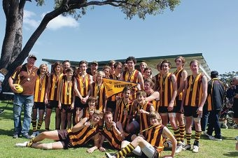 Dolphins players and officials celebrate their premiership.