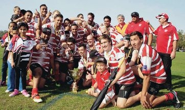 The ARKs second grade team celebrate their grand final win.