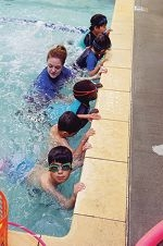 Swim School instructor Tayla Bothma with some of the boys during their holiday swimming classes.