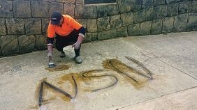 The unsightly graffiti tags on the Joondalup War Memorial.