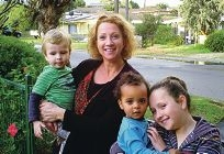 Award winning family day care educator Elizabeth Thompson holding Max Middelbosch and Ruby Thompson holding Kiana Braun.