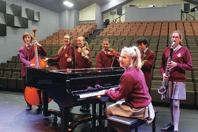 Warming up for the big concert: students from St Mark's Anglican Community School practising for their fundraiser.