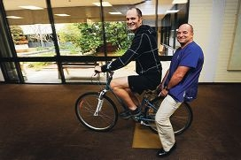 Peter Chwal and surgeon Professor Luc Delriviere ride down a corridor at Sir Charles Gairdner Hospital. Picture: Marcus Whisson d408507