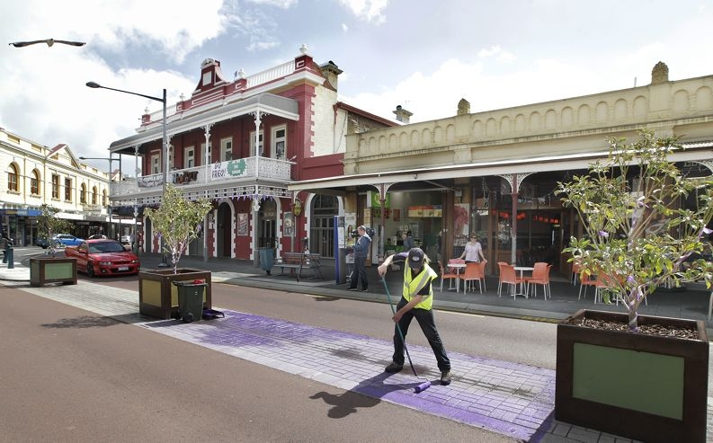 Purple paint being applied to the Cappuccino Strip on Wednesday. d408005