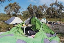 Storms damaged tents that four homeless people were living in.