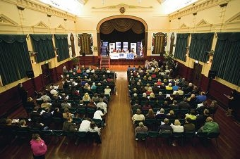 The historic hall was packed for the often-lively exchange of views during the forum.