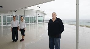 Jo Miguel (club administrator), Candace Yelavich (director of marketing) and Daryll Smith (director development) on the balcony of their new clubhouse.