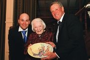 Jan Yurisich, son Ian (right) and grandson Anthony (left) with a handmade platter awarded in recognition of her late husband Vince.