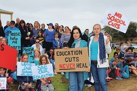 Secret Harbour parents, teachers and students rallied together over education cuts. There were similar protests at other locations.