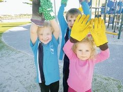 Averley Johnson (5), Adam Pryce (5) and Emeline Johnson (2) are taking the spring pledge.