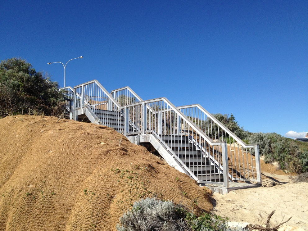 New stairs provide beach access at Fisherman's Hollow stairs.