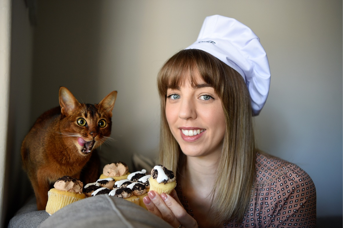 Hannah Friend with rescue cat and cupcake lover Fifi. Picture: Jon Hewson.