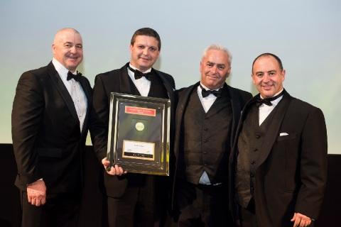 Presenter Conray Passaris, Acton Council, with award winners Jon Brady, John Brady and David Bombara.