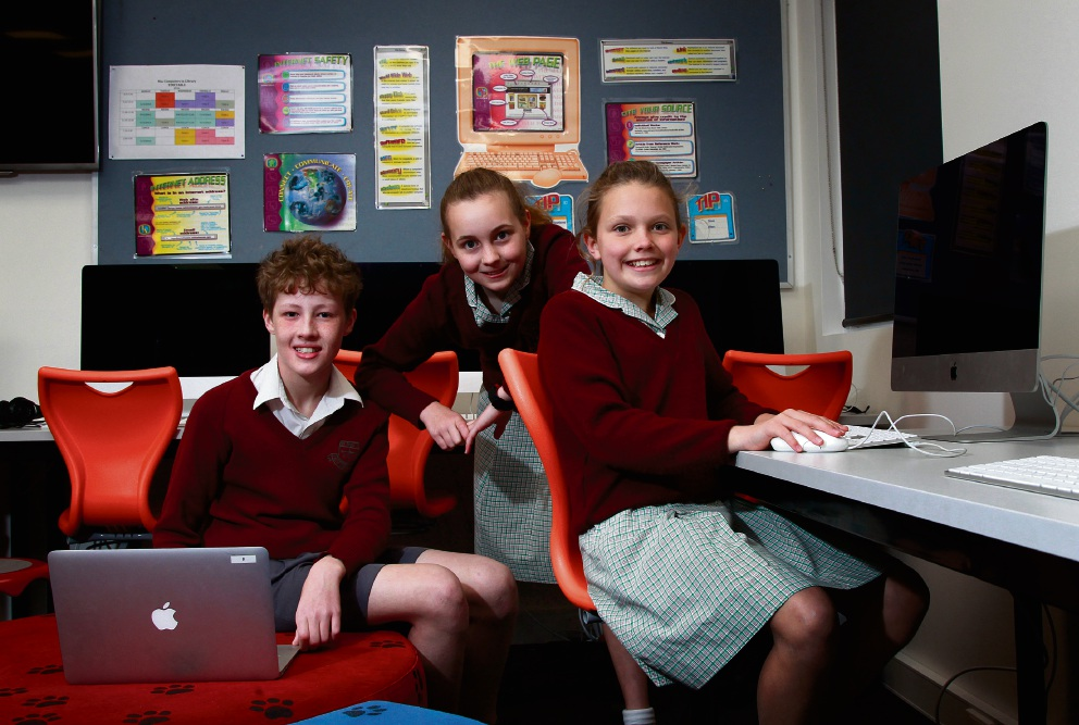 Harley Spencer (12), Tia Leigh (11) and Riley McCarthy (11) in the school's new library. Picture: Marie Nirme