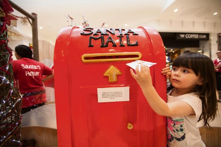 Jindalee resident Chloe Hart (3) sends her letter to Santa at Ocean Keys.