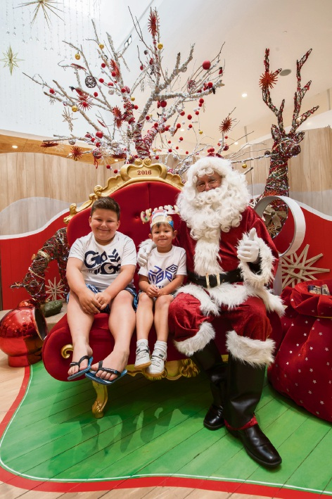 Marco (8) and Kiean (5) Letecier, of Clarkson with Santa.