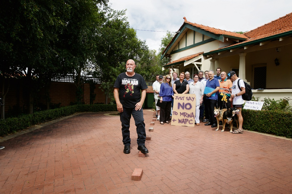 Resident Graeme Reany on Guildford Road with fellow residents concerned about the proposed widening that will affect hundreds of businesses and residents. Picture: Andrew Ritchie.