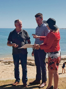 Premier Colin Barnett, Dawesville Liberal candidate Zac Kirkup and Mandurah Mayor Marina Vergone looks at plans for the shark enclosure.