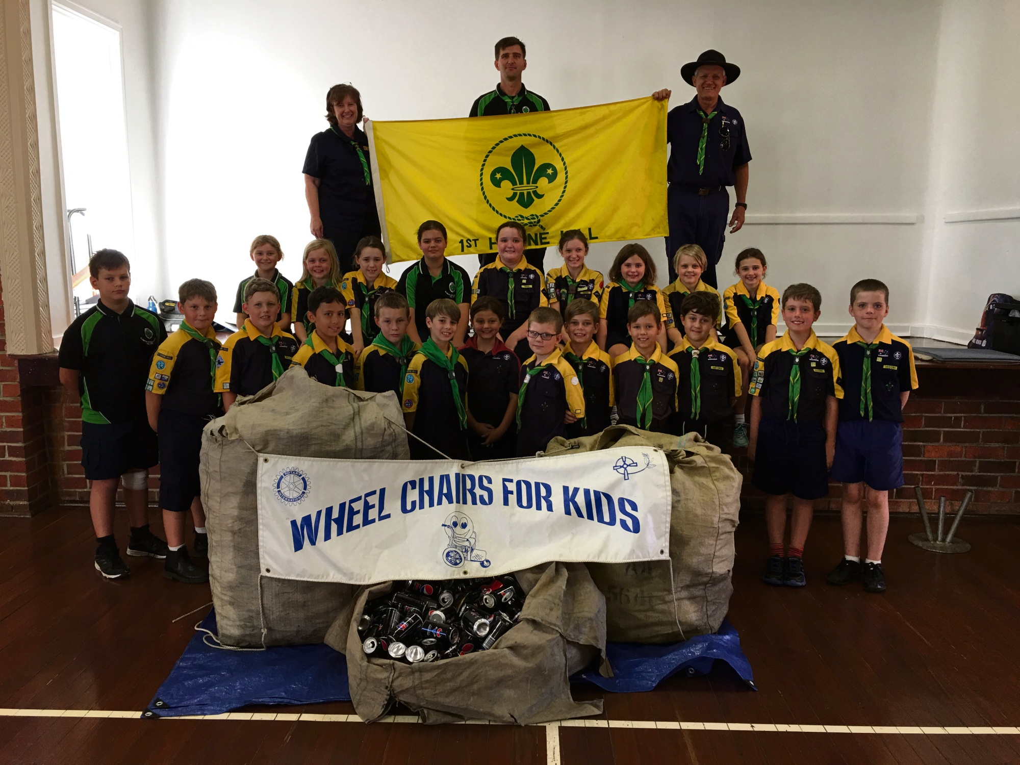 1st Herne Hill Cub Scouts with their collection of cans, which will be sold for recycling and the money used to build wheelchairs.