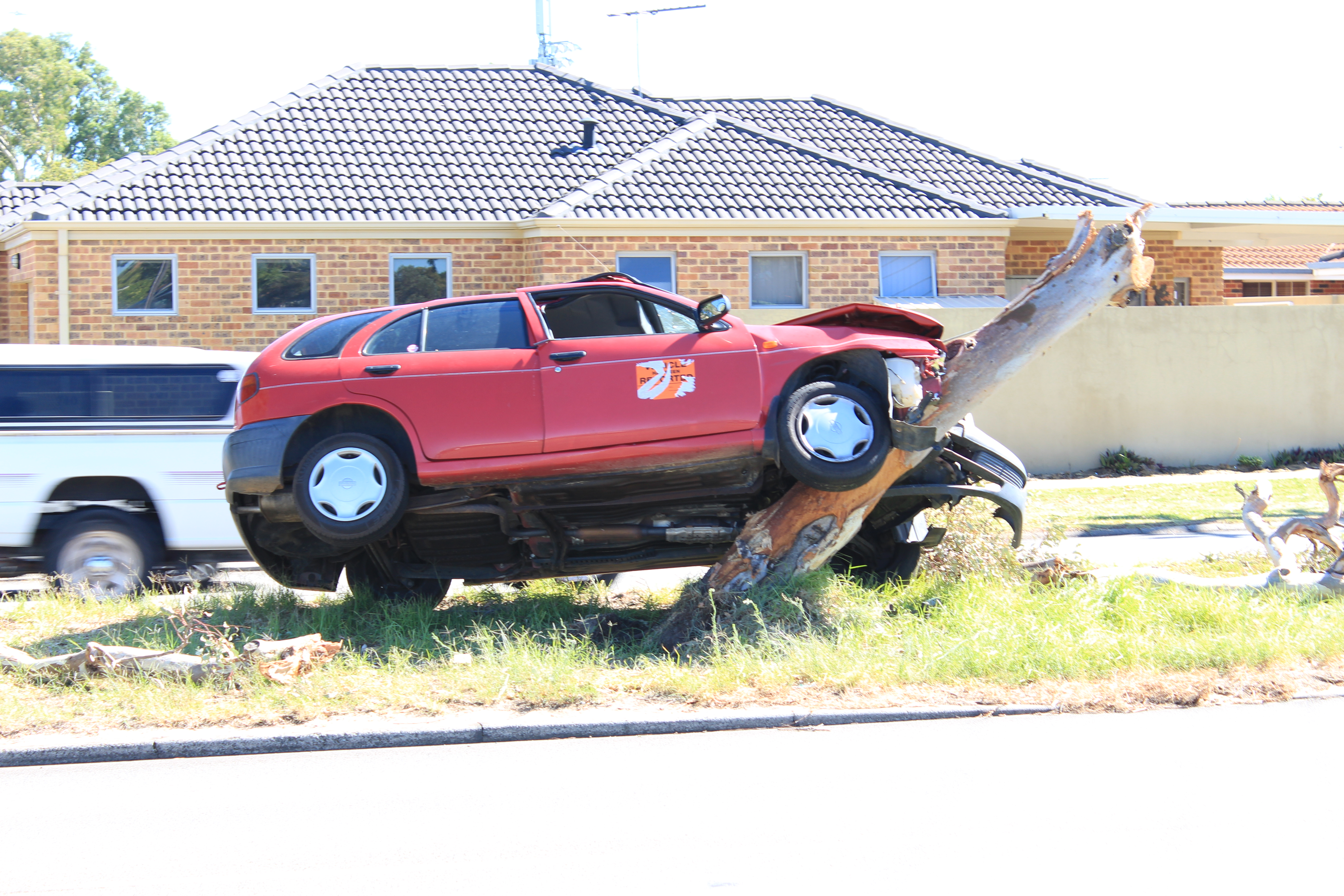 Karrinyup Rd: car in tree after accident on Saturday