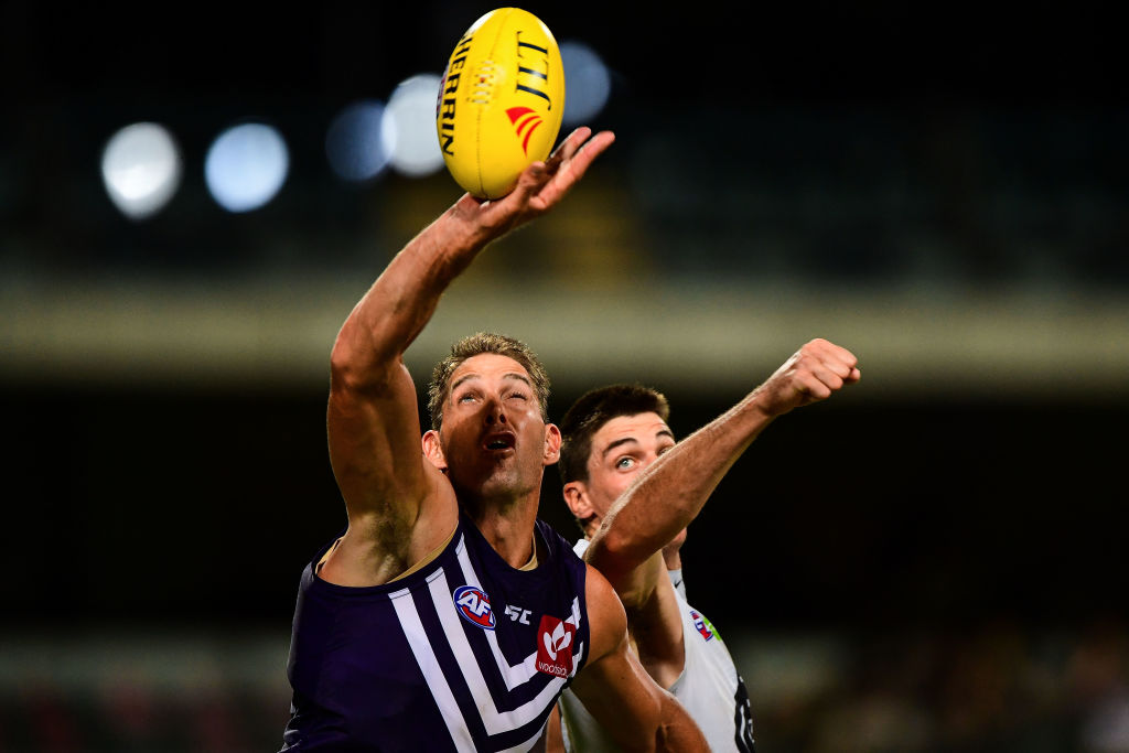 Aaron Sandilands contests a boundary throw in against Carlton's Matthew Kreuzer  during the AFL 2017 JLT Community Series match between the two sides at Subiaco Oval on March 10. Picture: Daniel Carson/AFL Media/Getty Images