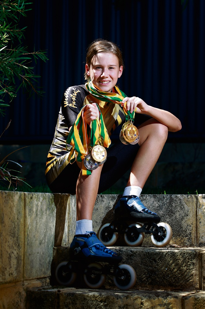 Speed skater Asha Hickford with her medals. 