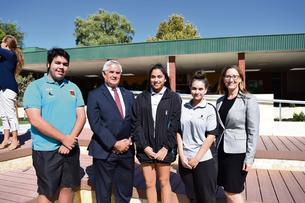 Hasluck MHR Ken Wyatt and principal Melesha Sands with Year 11 students Tiahni Flakemore, Taya Woods and Rohan Holiner.  Picture: Sarah Brookes