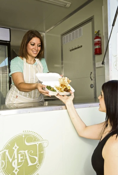 WA Mobile Food Vendors Association vice-president Sandra Bahbah serves a customer from her Middle Eastern food van.