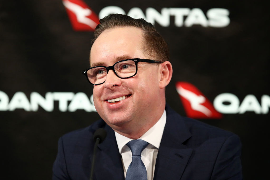 Qantas Airways chief gets slapped on the face with pie on stage
