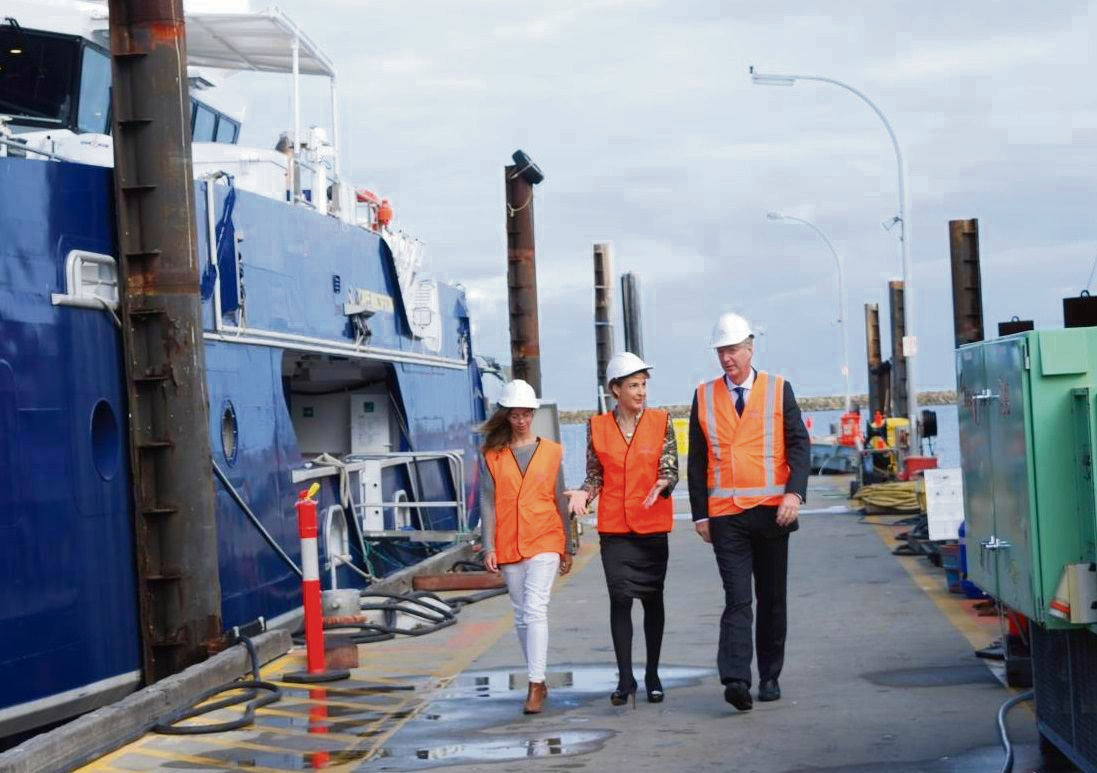 Austal's 100th designer Abby Krause, Senator Michaelia Cash and Austal chief executive  David Singleton  at the company's Henderson facility.