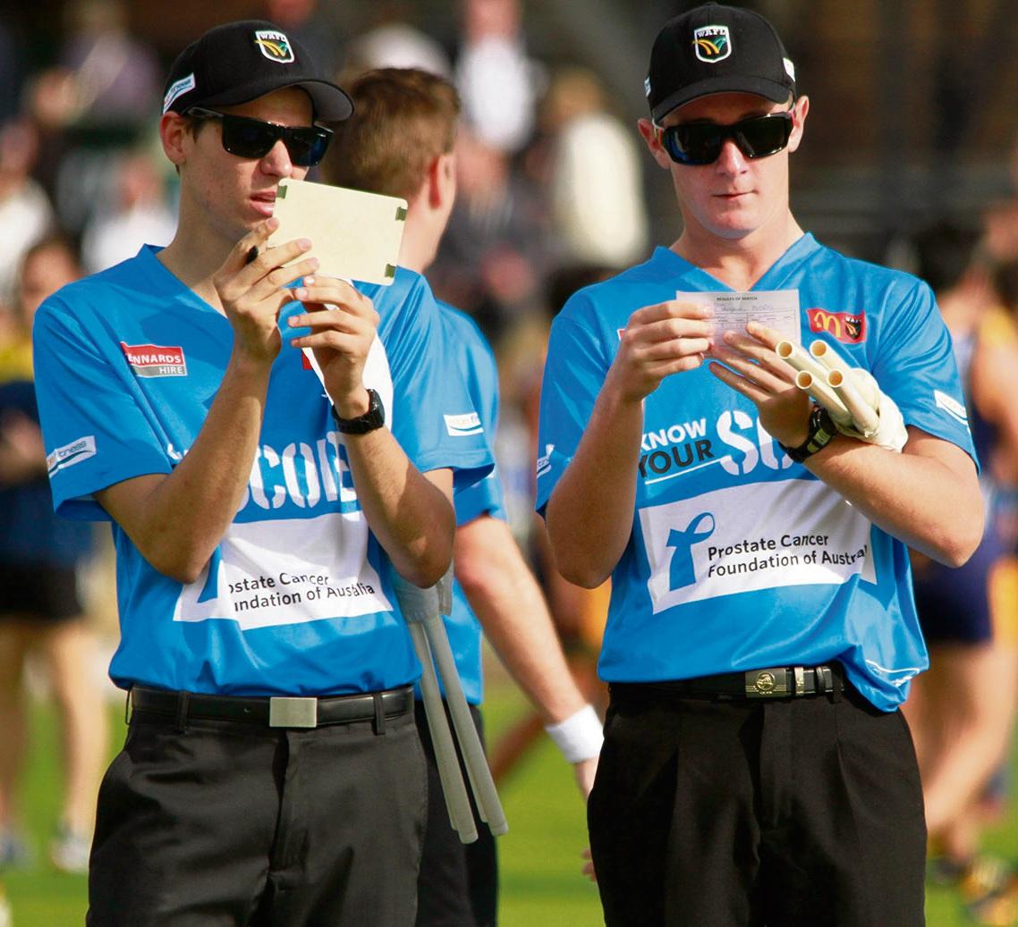 Goal umpires confer in blue.