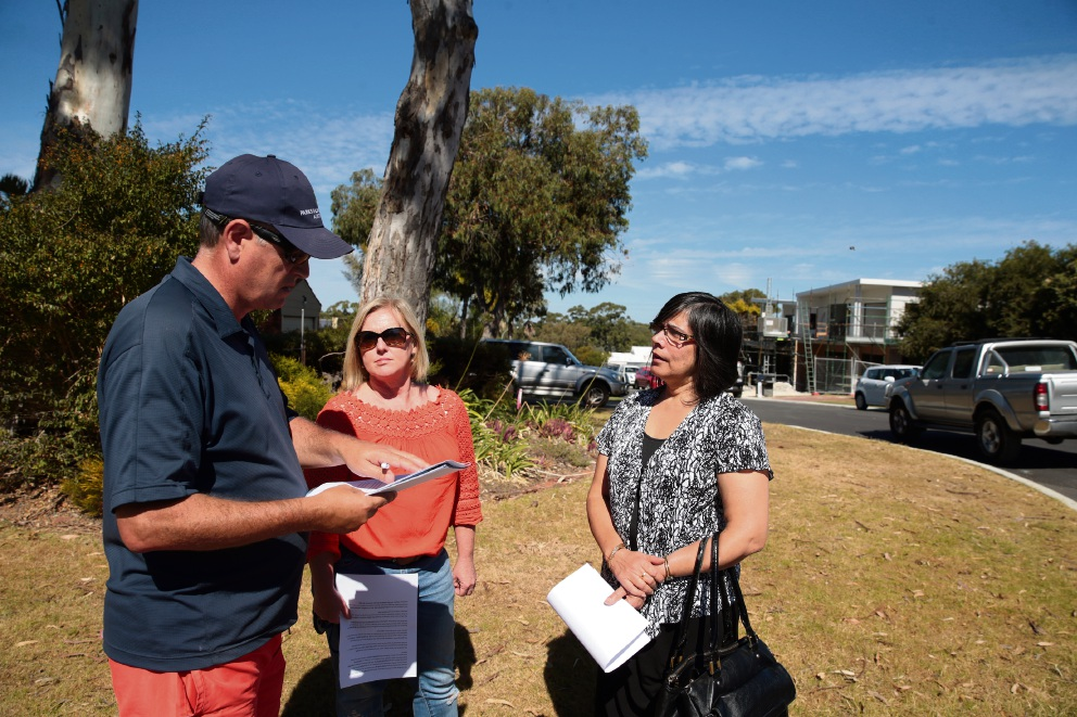 Local residents Chris Shaw, Leanne Panetta and Namita Mehra discussing redevelopment plans in their area.