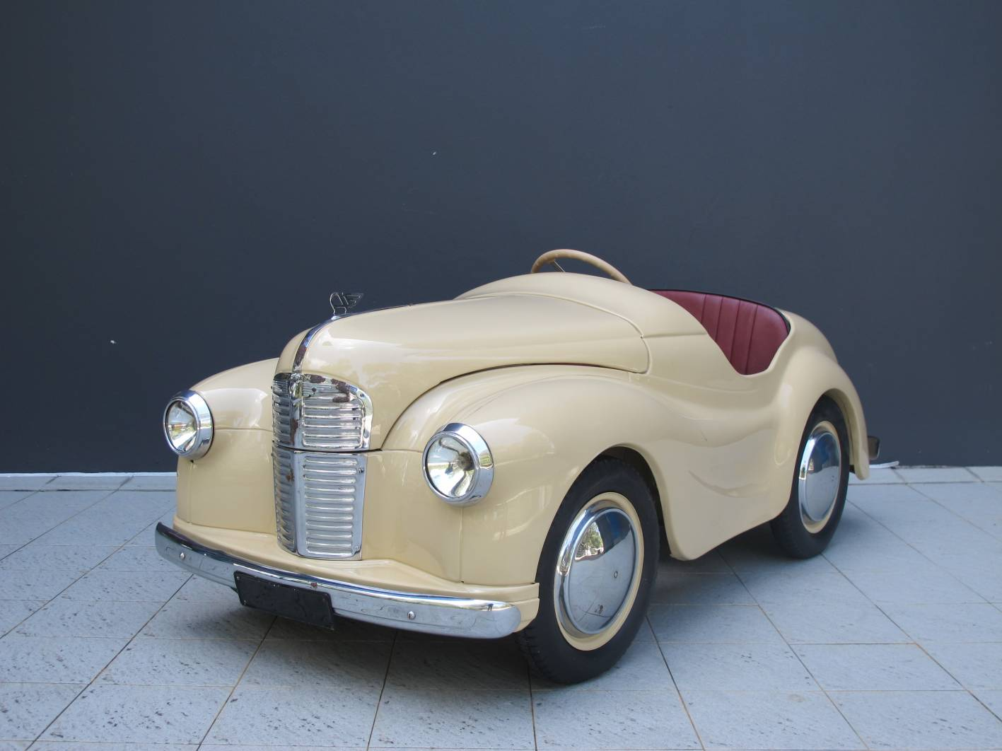 This child's 1950s pedal car sold for $9300 at auction.