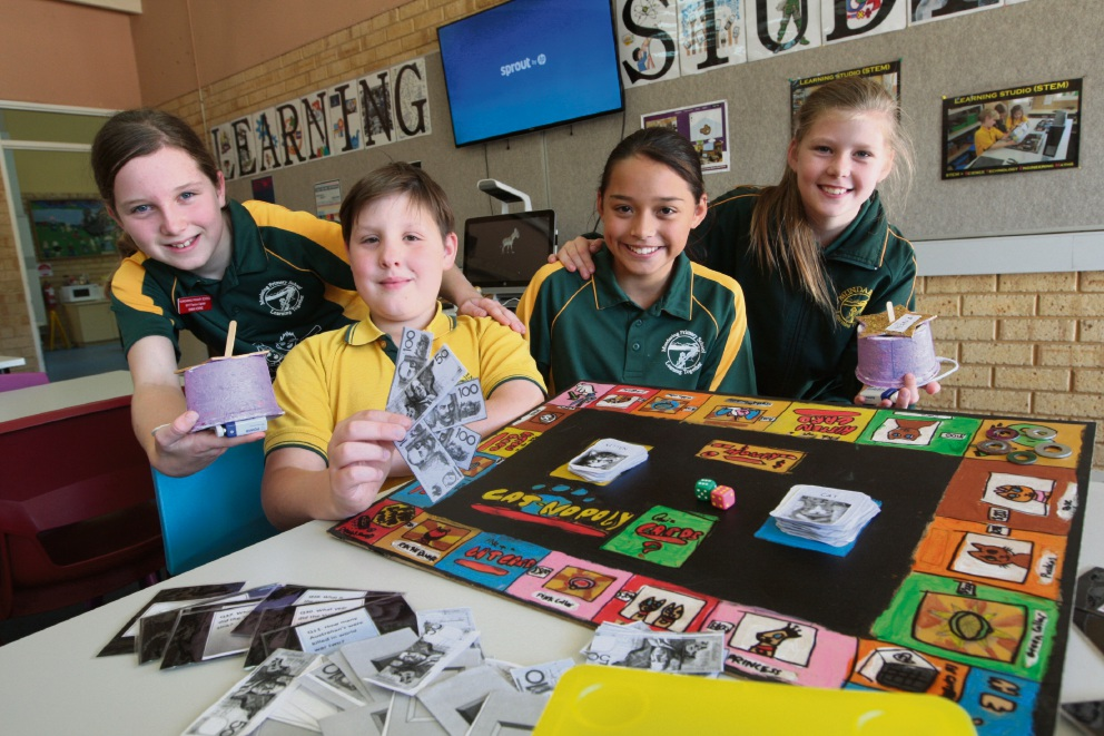 Mundaring Primary School students with the board games and bridge they created through the Learning Studios program.