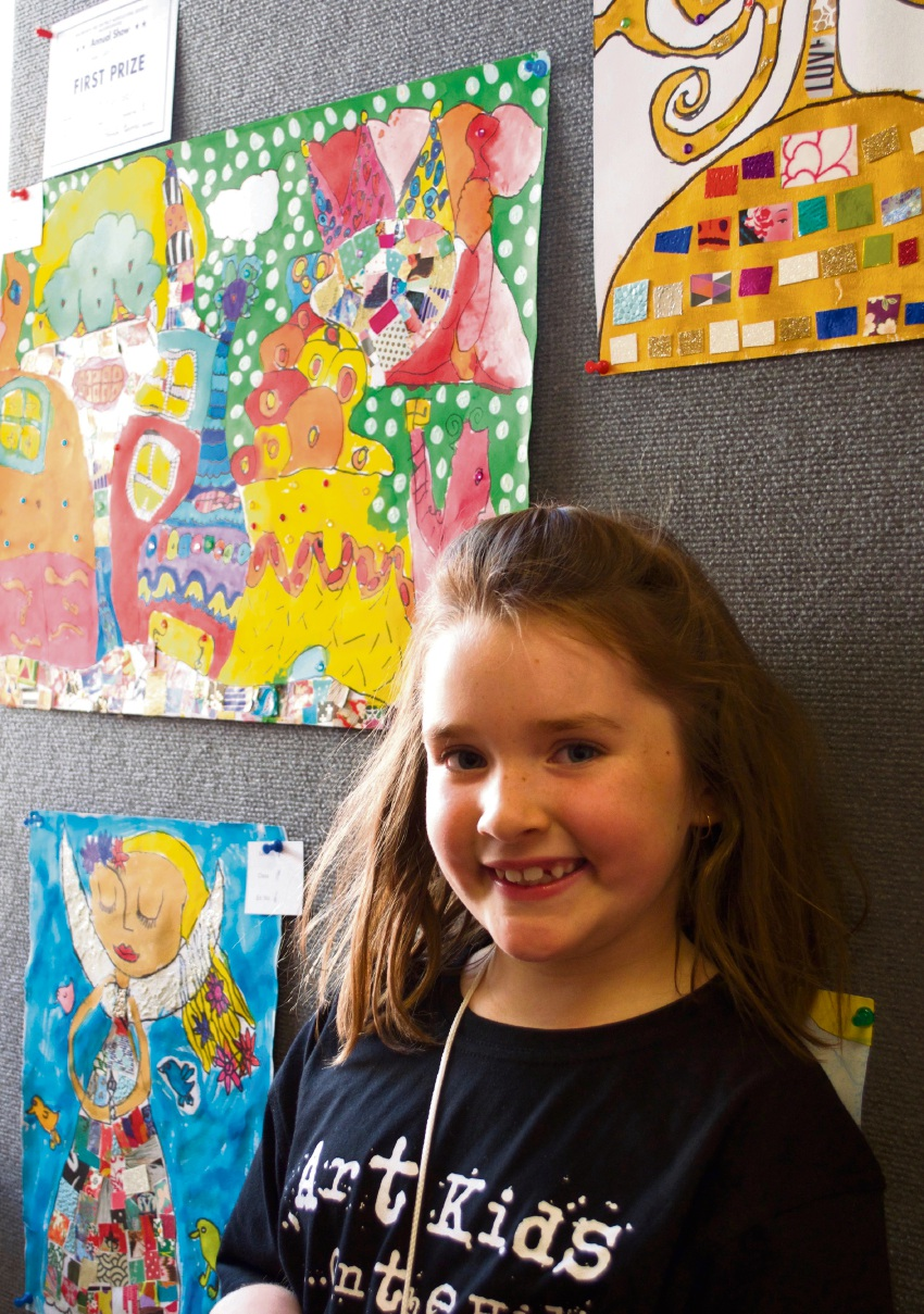Year 2 student Scarlett Harrison with her artwork Crazy Dream (top left).