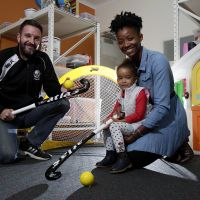 Vice President Fremantle Hockey Club Matt Allen with Oumou Bah and her daughter Samara Chentelat (2.5 y old) having a play with the hockey gear. Picture: Marie Nirme