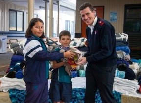Beechboro Christian School students Rochelle Royal and Elijah Merrels with Salvation Army Lt Ben Hollis.