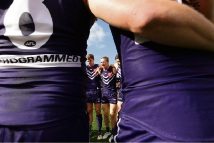 Nat Fyfe speaks to the huddle at the start of the derby. Picture: Will Russell/AFL Media/Getty Images