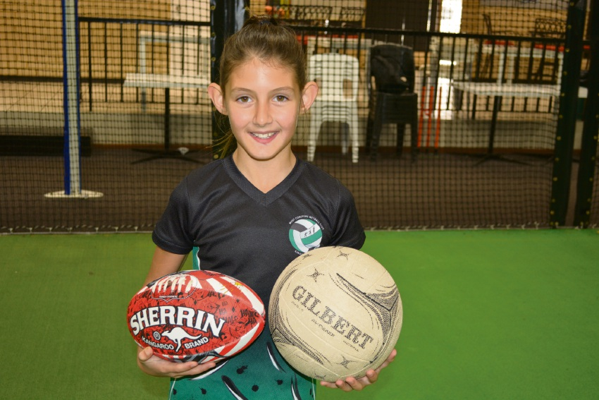 Mia Russo excels at netball and Aussie rules.