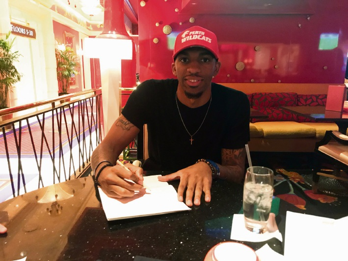 Devondrick Walker signs on the dotted line in Vegas for the Wildcats.