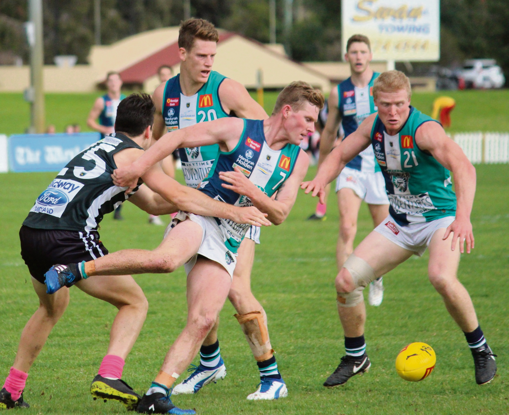 Matthew Taberner, Brayden Lawler and Blair Bell close in on the footy.
