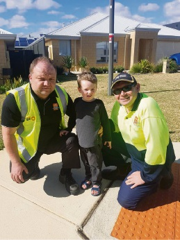 Waste Collection Coordinator Mickey Danilov and driver Frank Trolio with Reece Campbell.