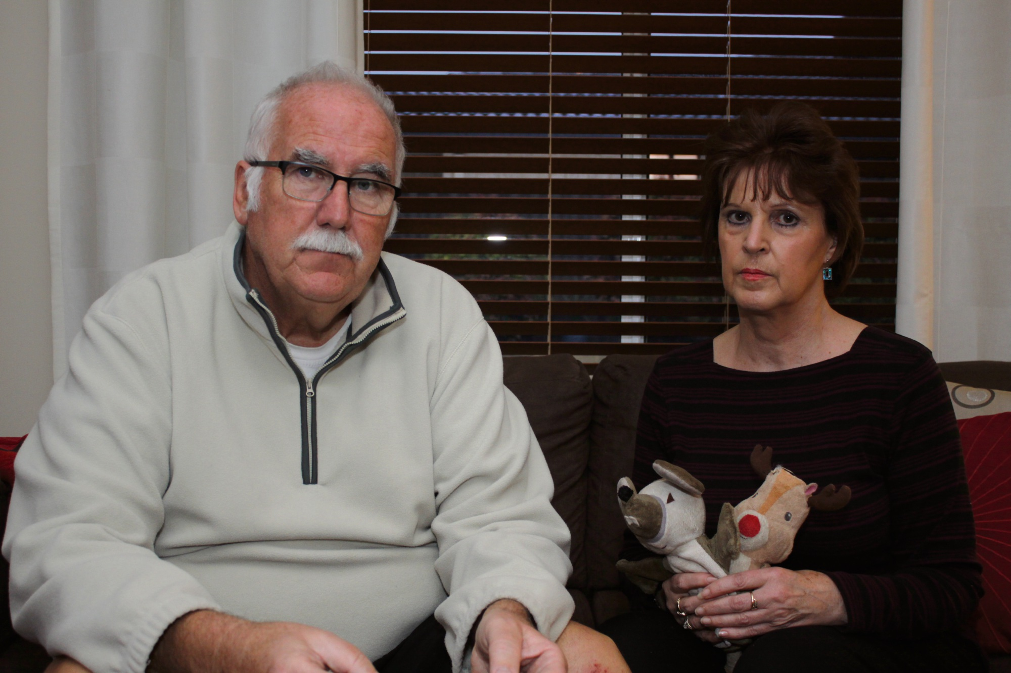 A heartbroken Tony Cronshaw and his wife Jenny with Rusty's toys.