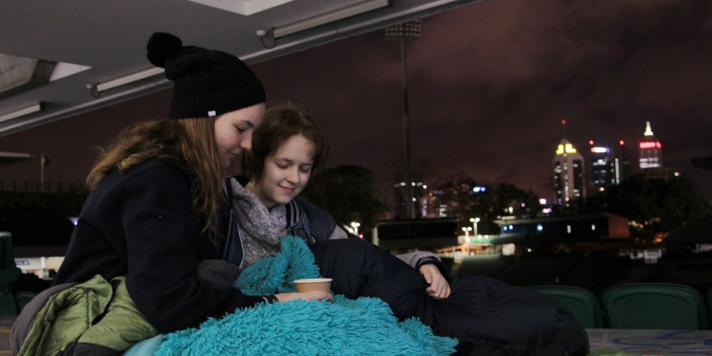 John Wollaston Anglican Community School students Emma Winship and Rhiannon Biair sleeping at Perth Oval in East Perth. Picture: Sean Middleton.