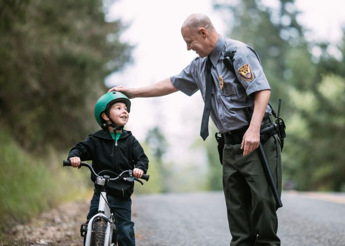 This policeman knows that bicycle helmets save lives. Stock picture
